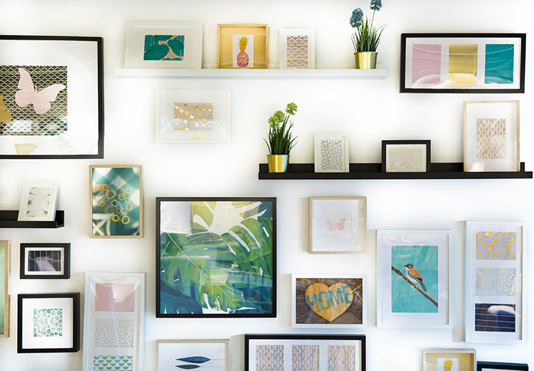 Assorted picture frames on a wall